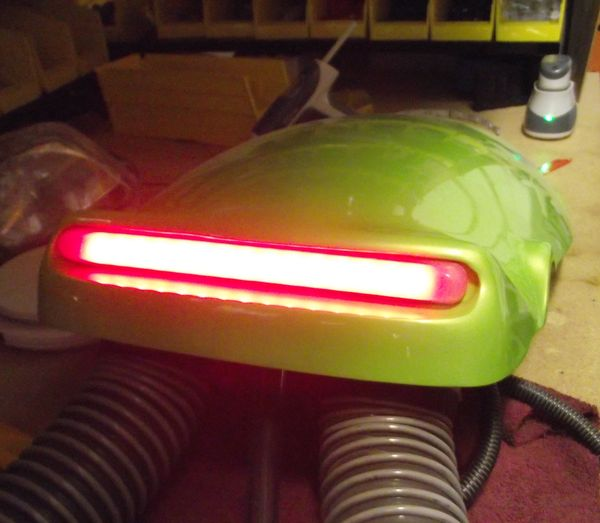 Easy replacement rear scoop light assembly